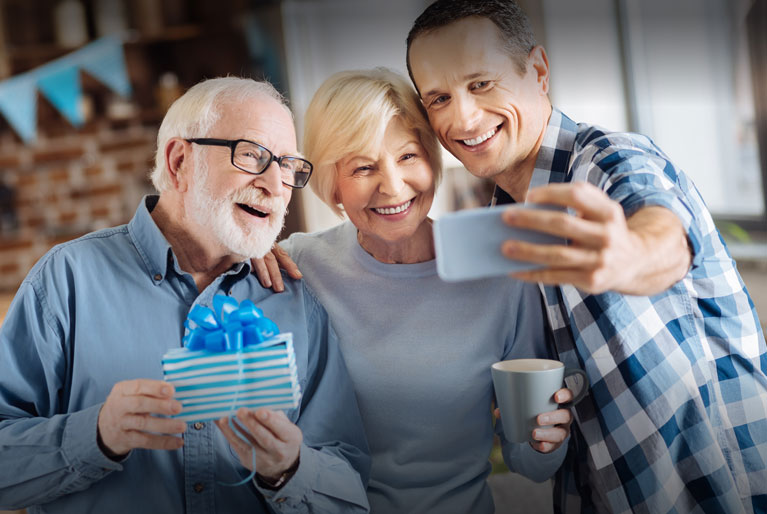 Banner Image | Family smiling and taking a selfie.