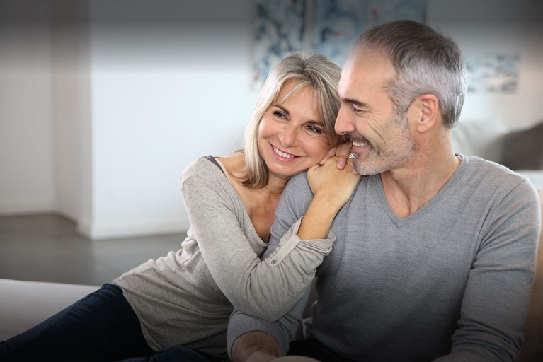 Banner Image | Middle aged couple smiling.